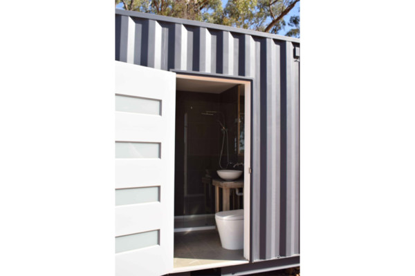 Shipping container temporary bathroom solution