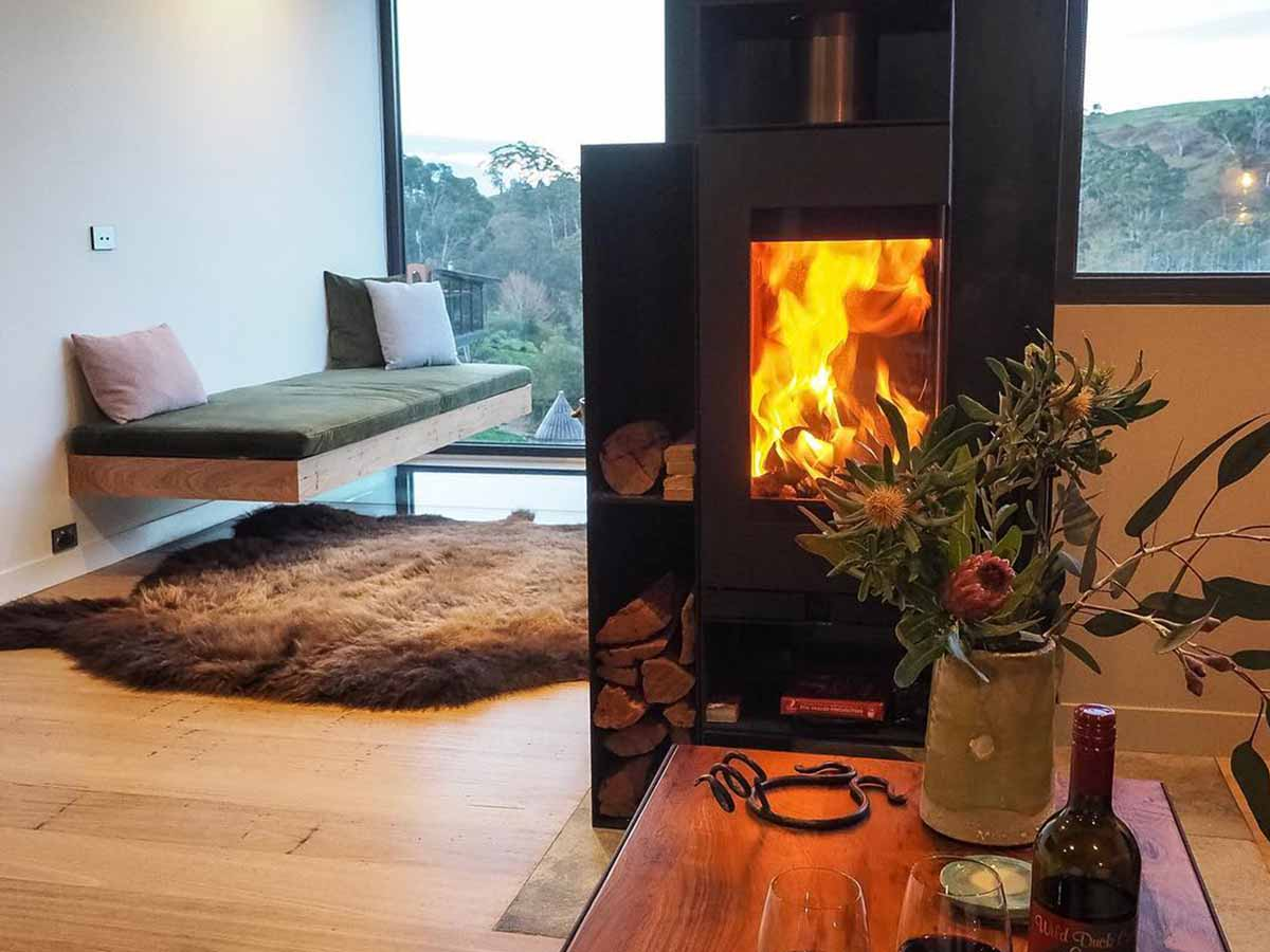 Shipping container home interior fireplace view